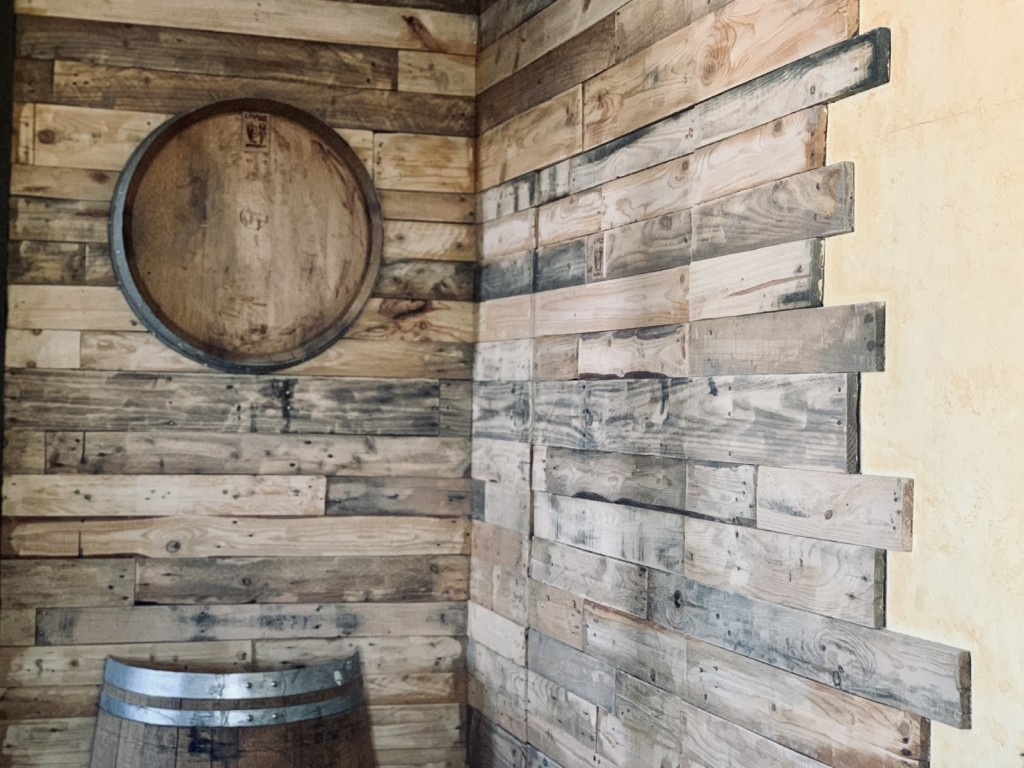Upcycled pallet wood adorns the wall in the tasting room.
